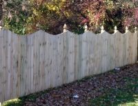 Solid Privacy Fence with Concave Scallop Gothic Post Tops