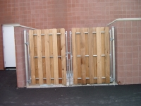 Dumpster Enclosure Board on Board attached to Masonry